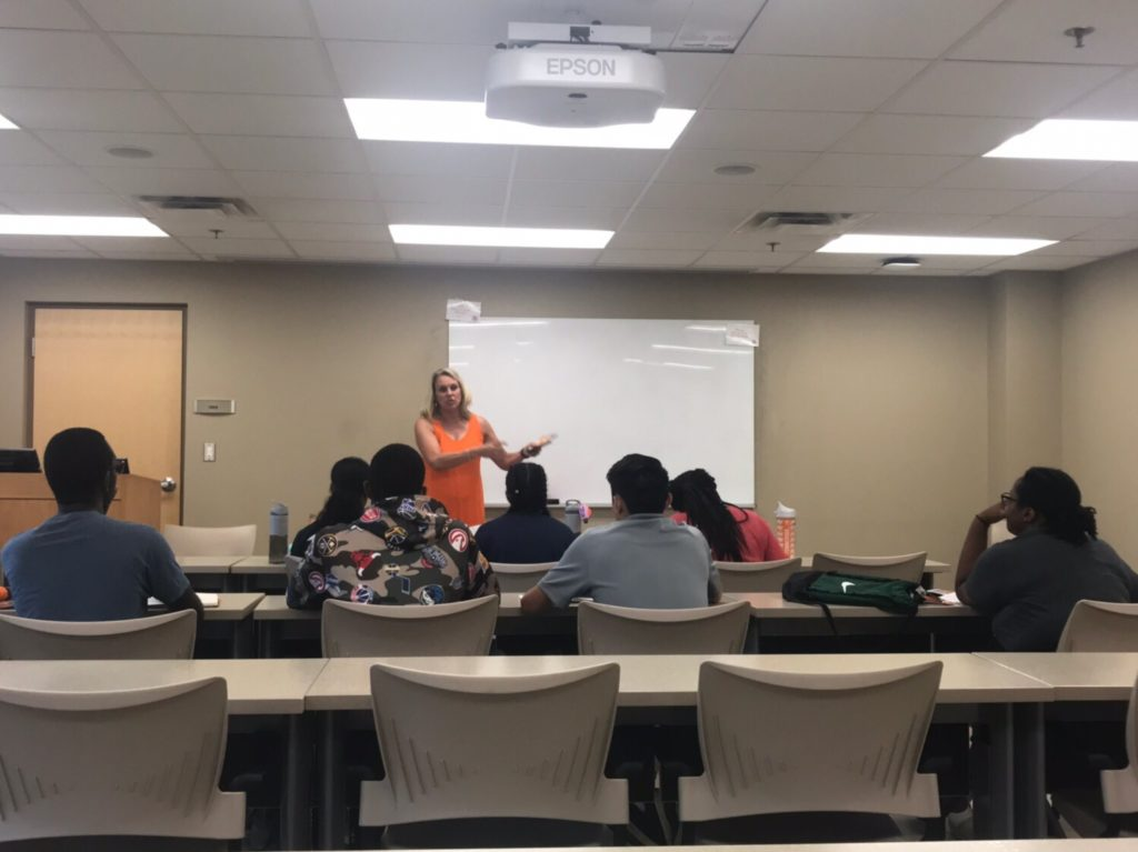 Dr. Stephens teaching a leadership lesson to Herbert College Connections students.