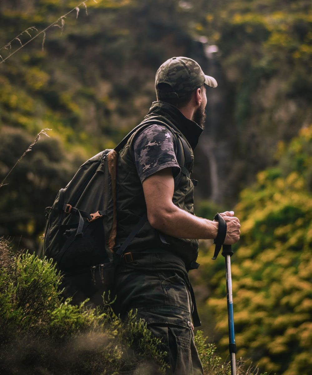 Male hiking with walking stick